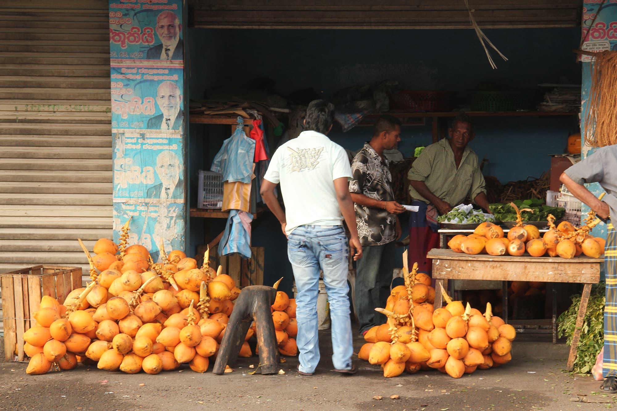 Locals barter over fruit in a market in sri Lanka