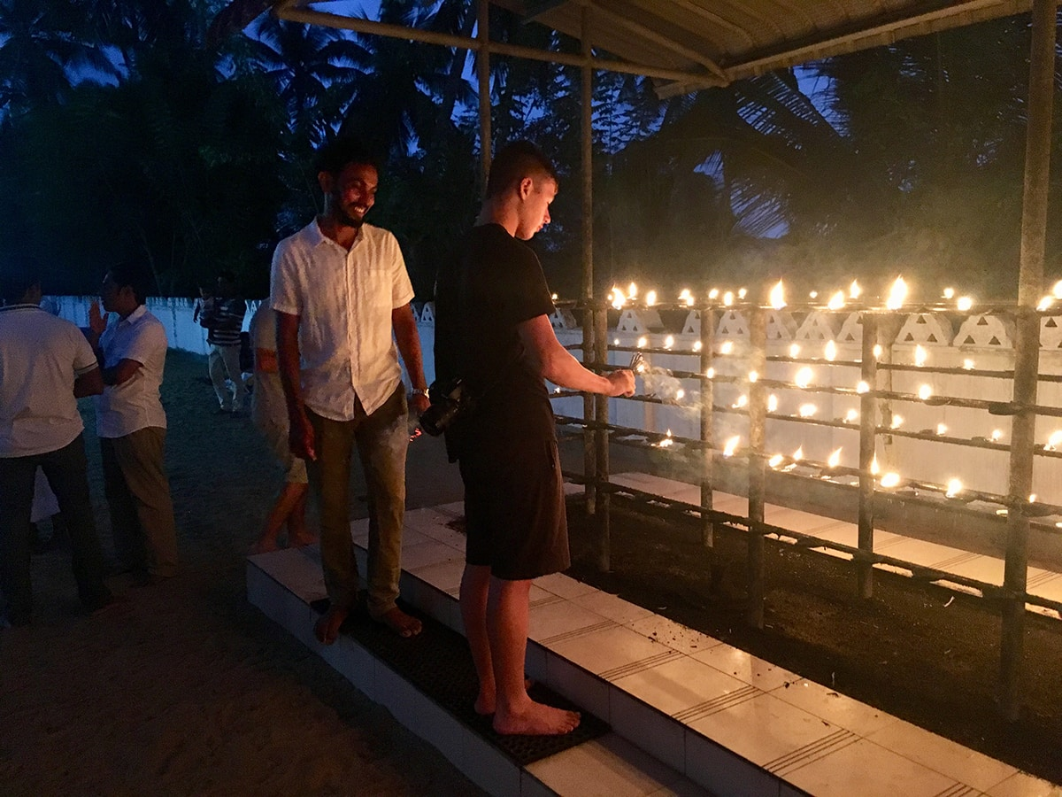 Candle lighting at temple Poya day Sri Lanka