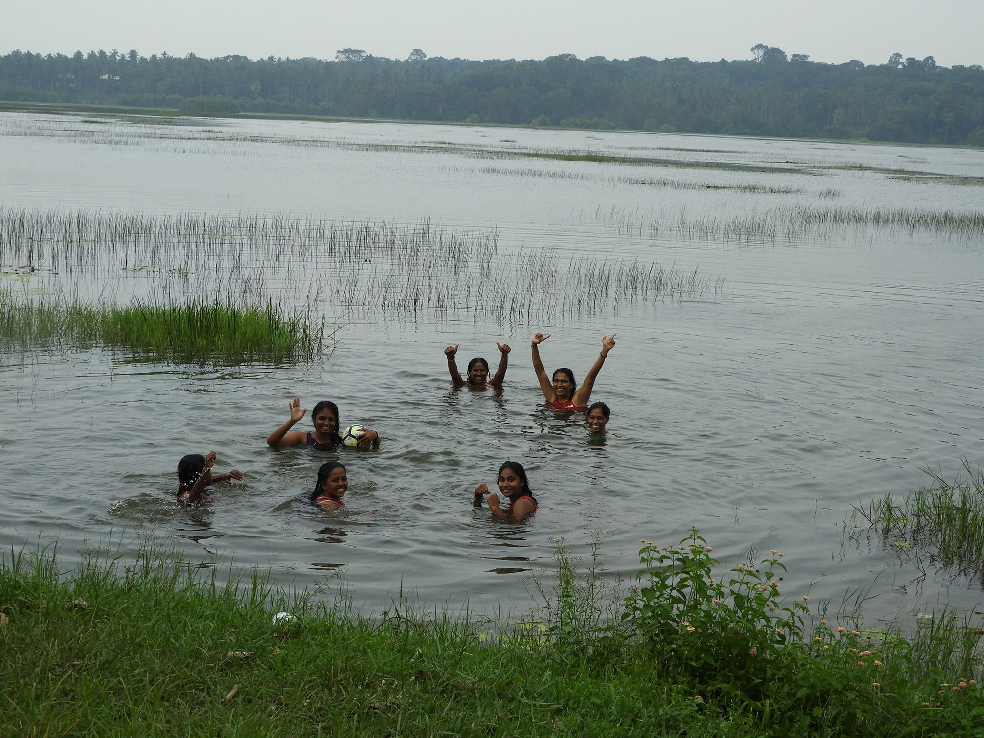 Family swimming in Sri Lanka