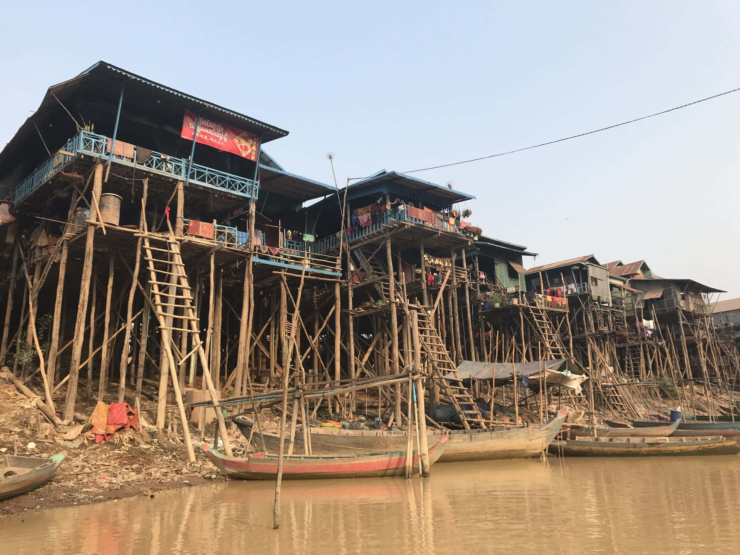 Kampong Phluk stilted buildings from below in a boat