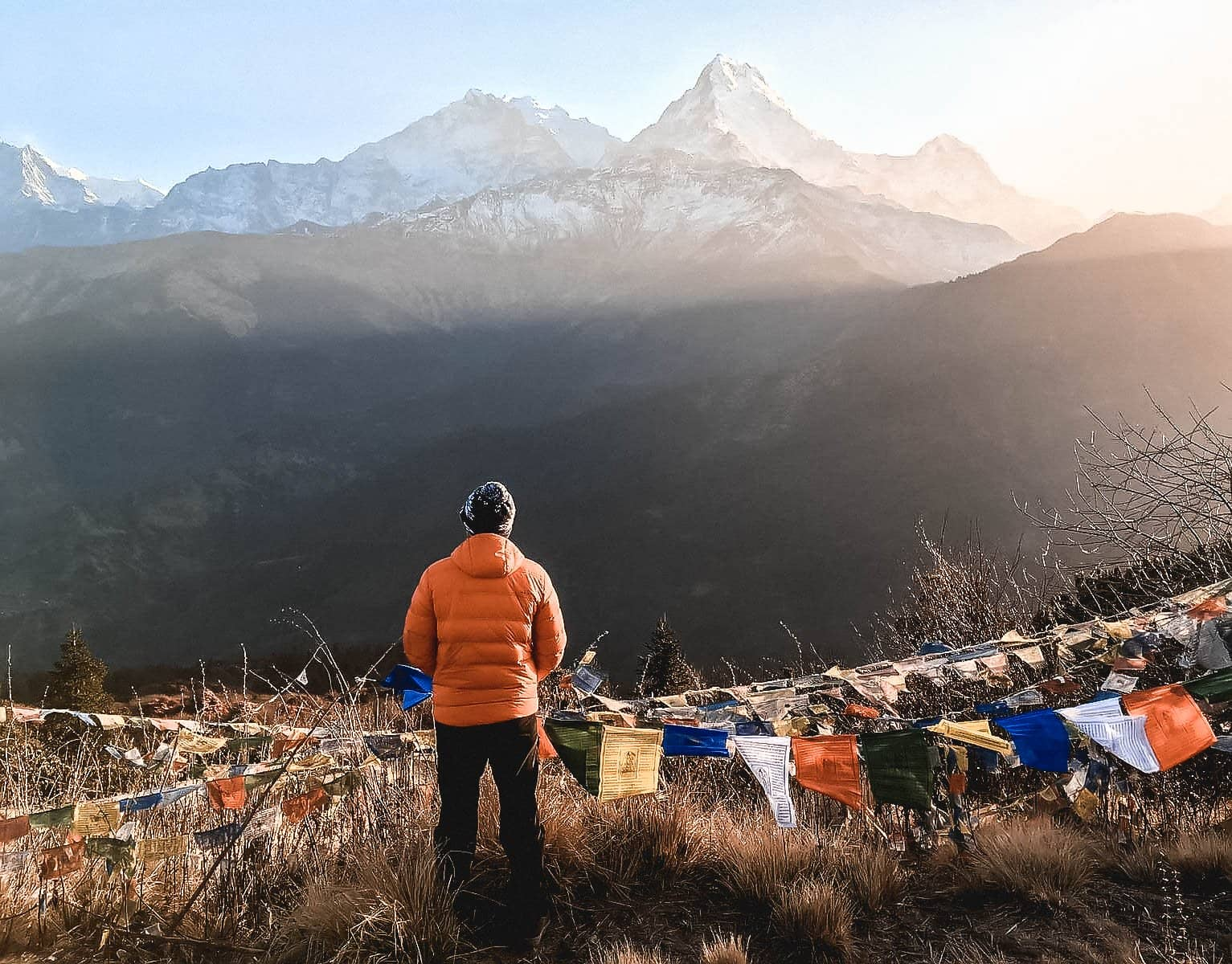 Traveller with prayer flags in the Himalayas