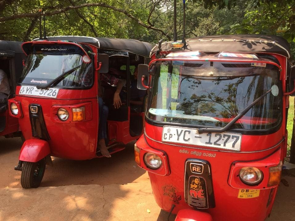 Two red tuk tuks in Sri Lanka