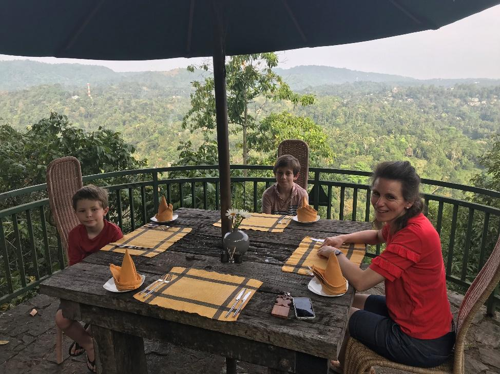A Family Dining Sri Lanka with a great view behind them