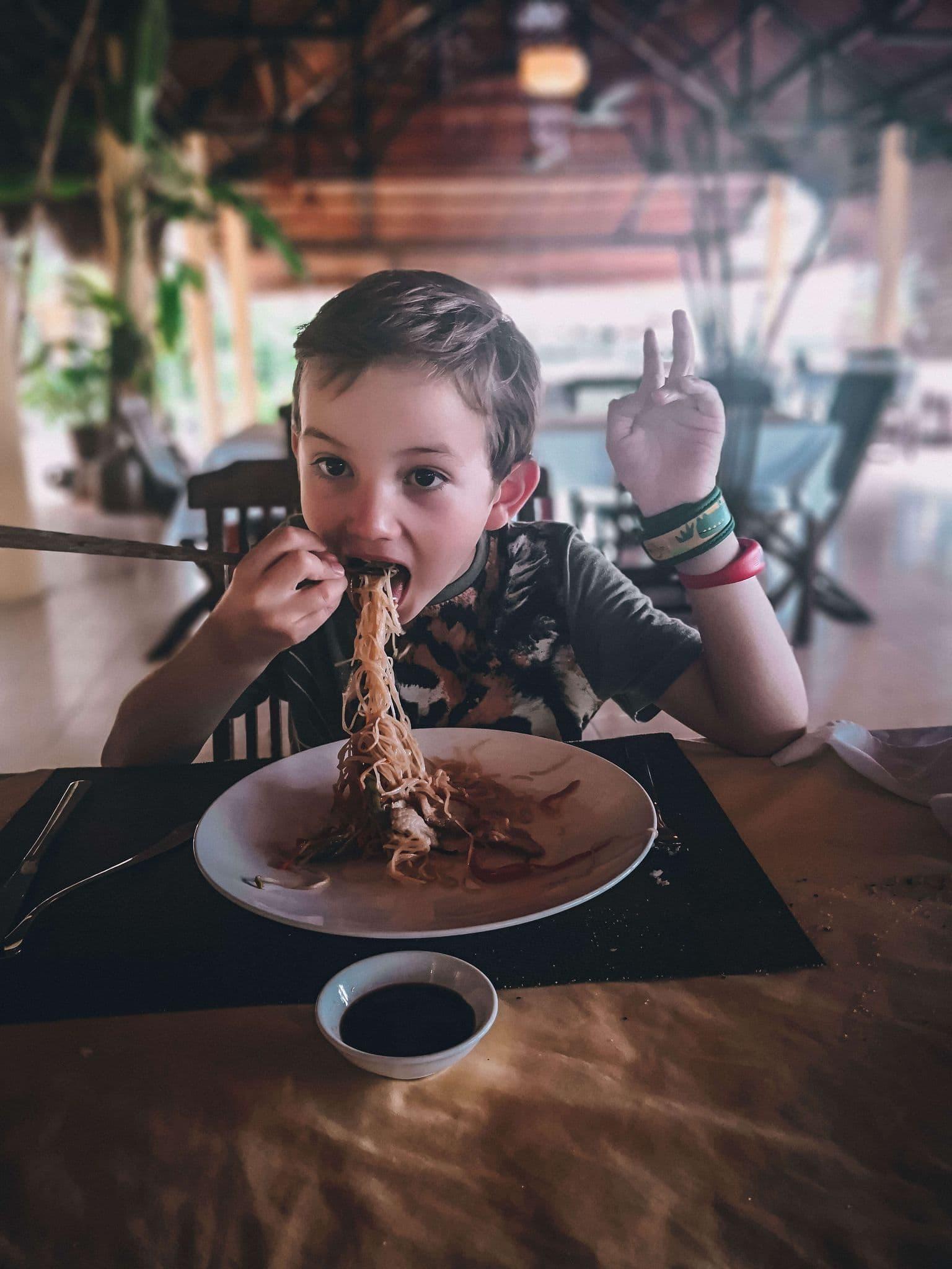 Child eating streetfood in Vietnam