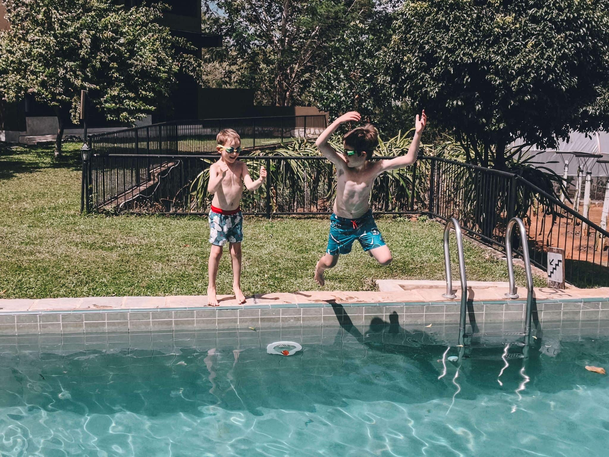 Kids jumping into a pool on a family holiday to Asia