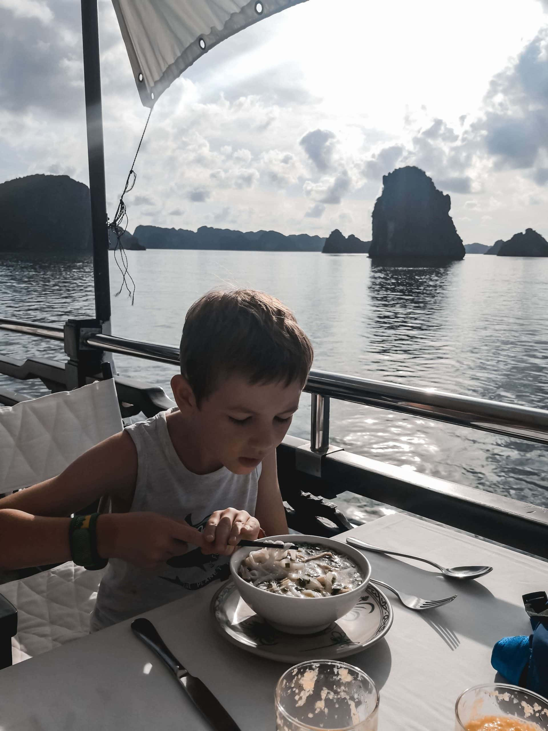 Having lunch whilst cruising Ha Long Bay on a family holiday to Vietnam