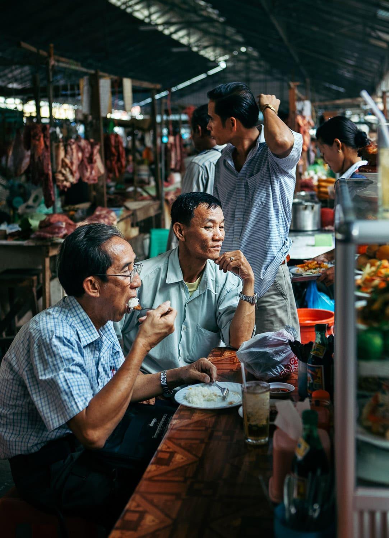 Locals eating in a Phnom Penh, market, Cambodia