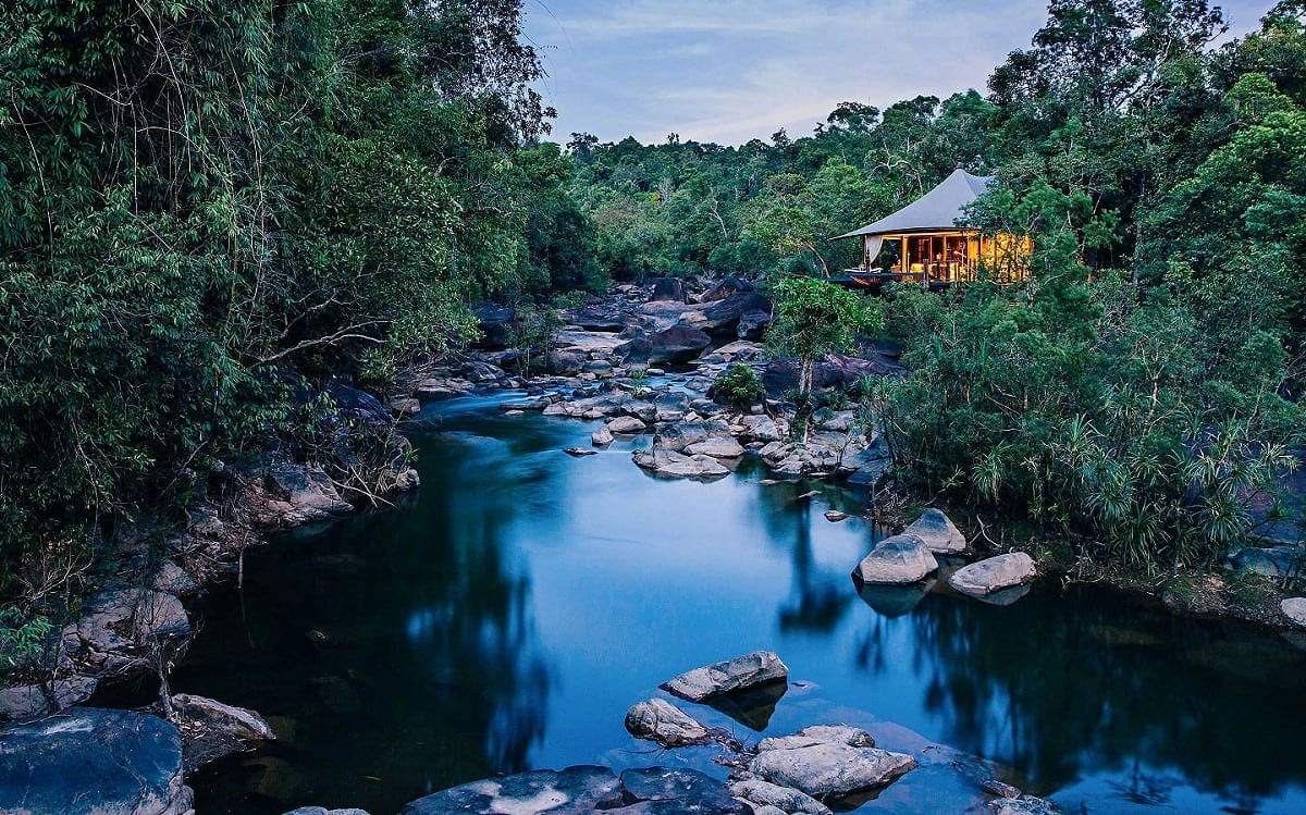 A luxury tent at Shinta Mani Wild overlooking the river in the heart of the Cardamom Mountains