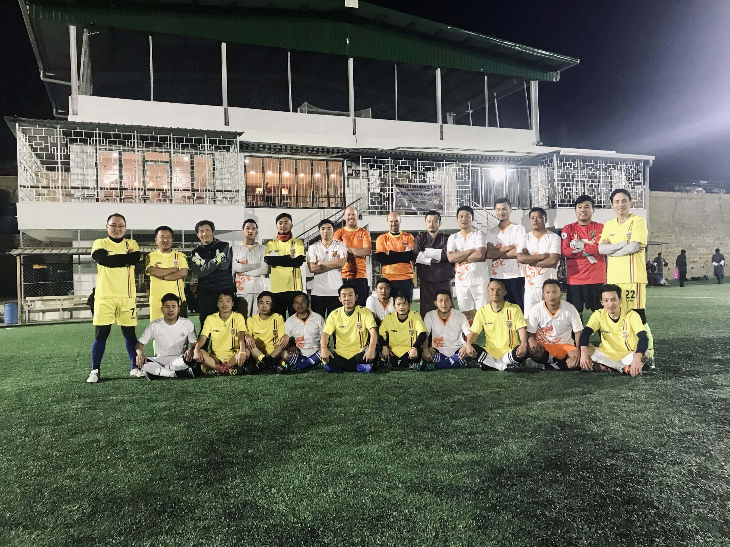Two teams after a football game in Bhutan
