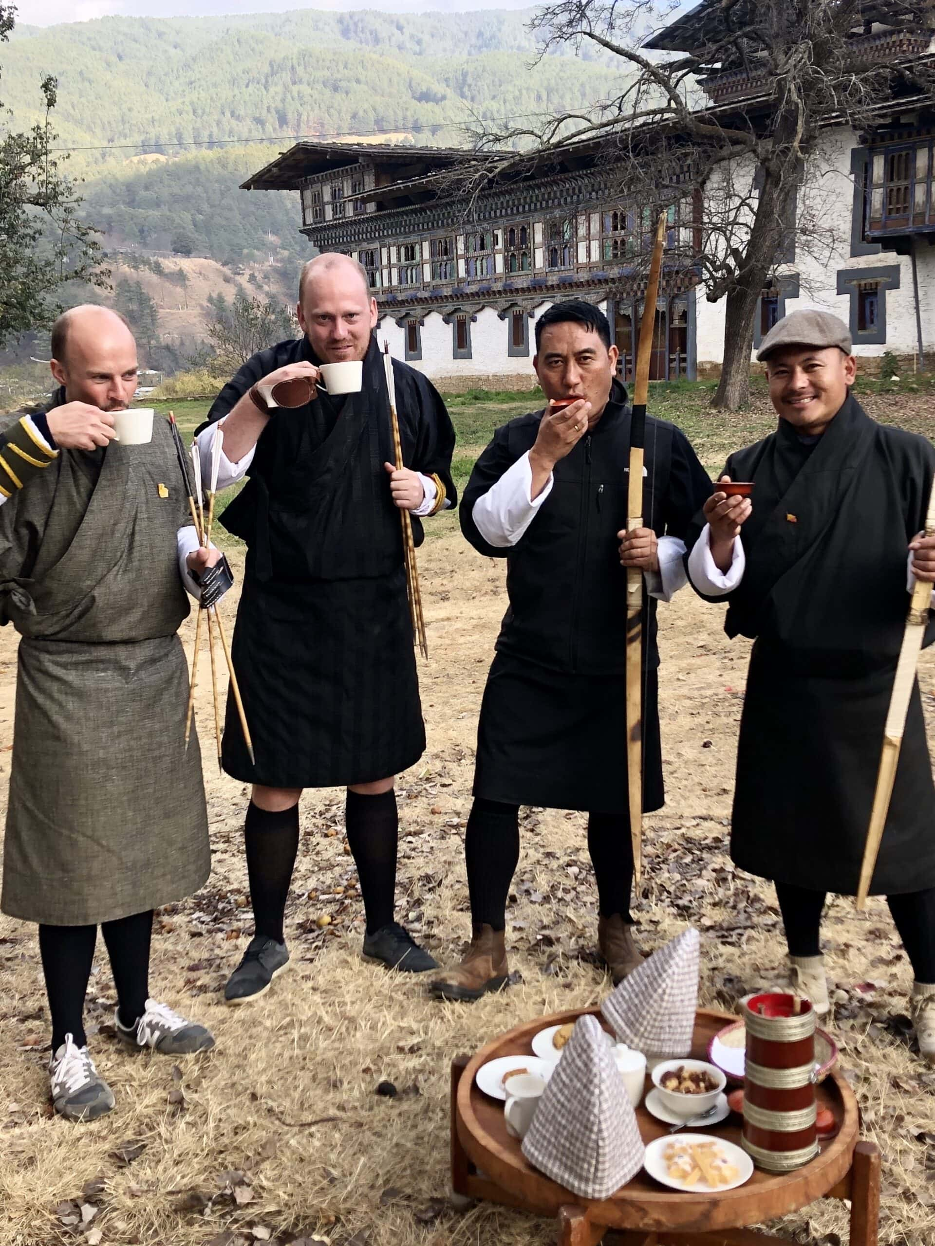 Travellers and guides taking a break from archery at Aman Bumthang in Bhutan
