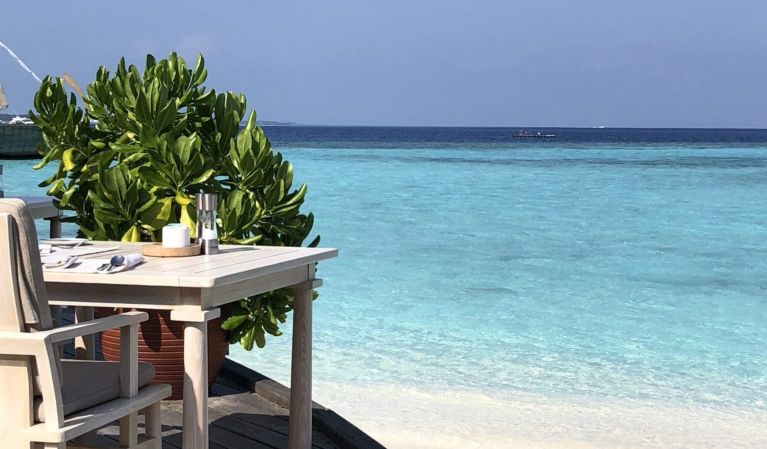 Dining view of the beach and sea at a Maldives resort