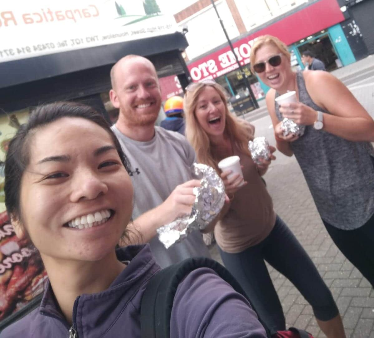 Four people smiling in London