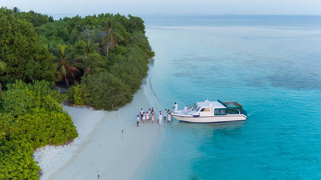 Boat on the beachside with travellers from Soneva Fushi island in the Maldives
