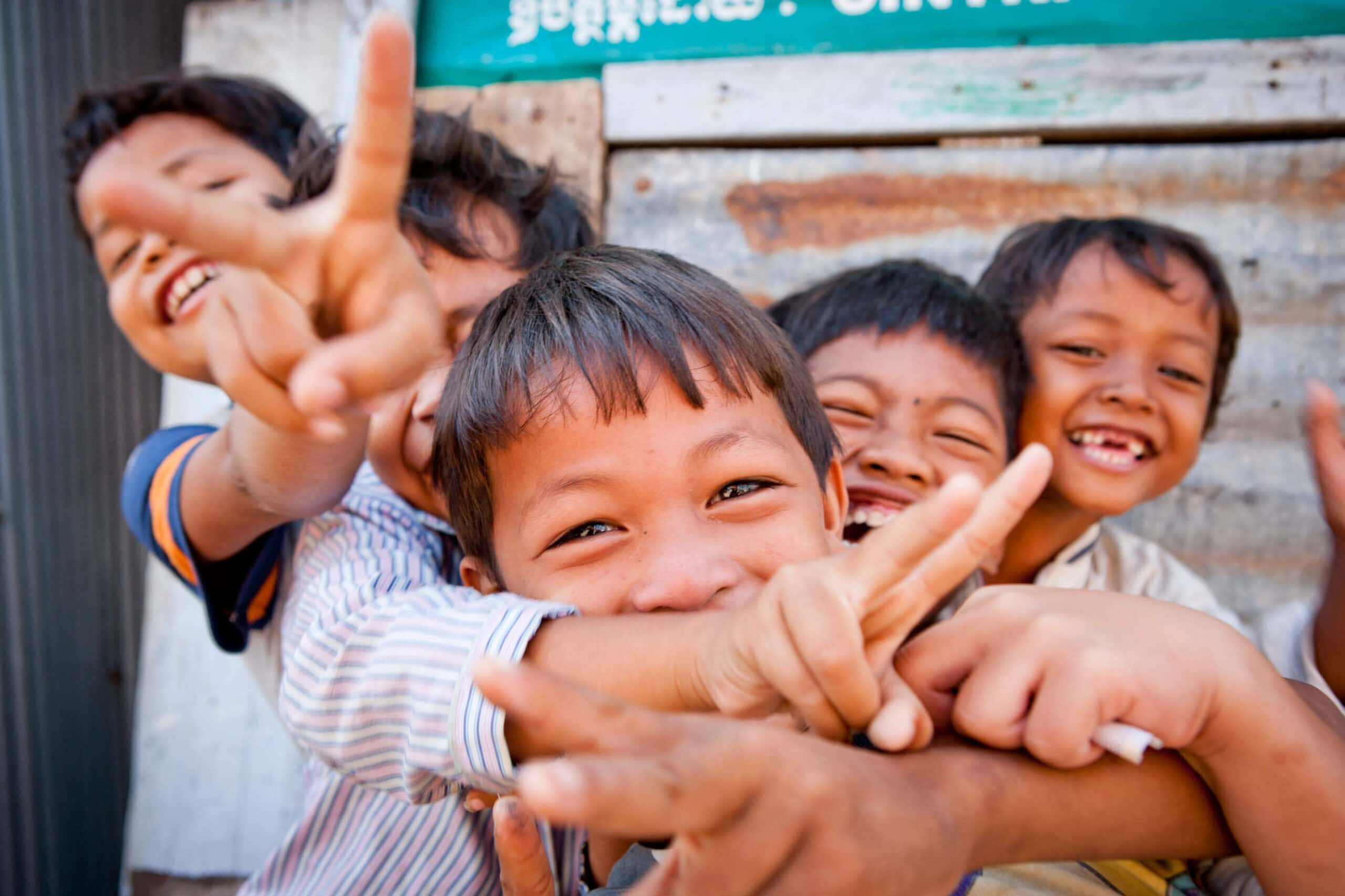 Children laughing on day trip with Save the Wonder in Cambodia